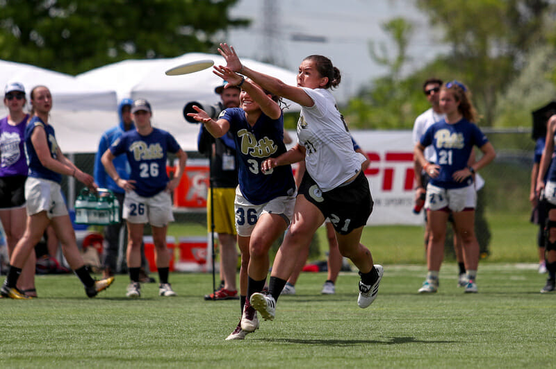 Colorado's Saioa Lostra pressuring Carolyn Normile against Pittsburgh in the semifinals of the 2018 College Championships.
