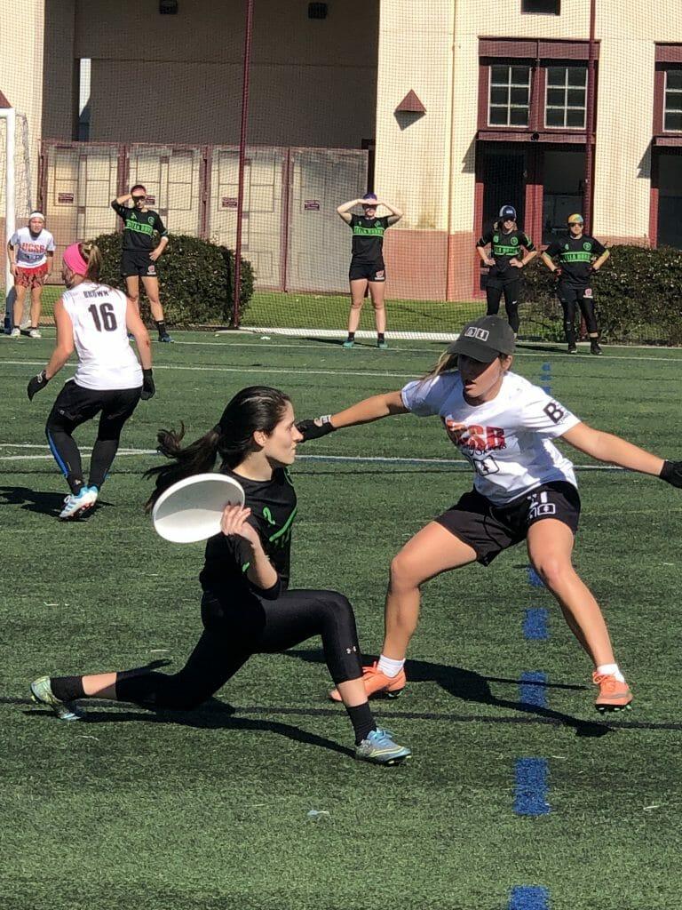 Wisconsin's Sabrina Hoffman throws against UC Santa Barbara's Mikaela Leslie at the 2019 Santa Barbara Invite.