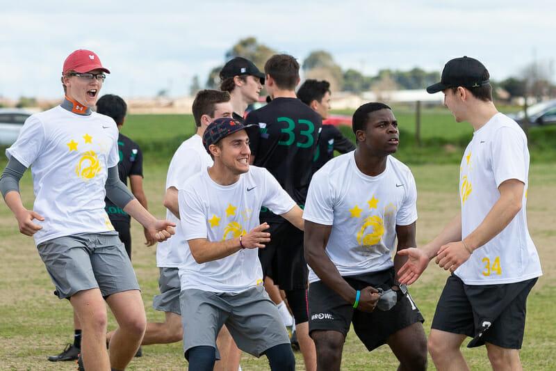 Brown's Azeez Adeyemi flexes as his teammates get hype at Stanford Invite 2019.