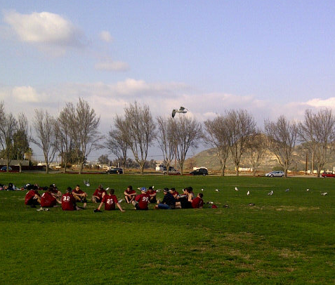 Puget Sound in the huddle after their DIII Warmup victory in Riverside, CA.