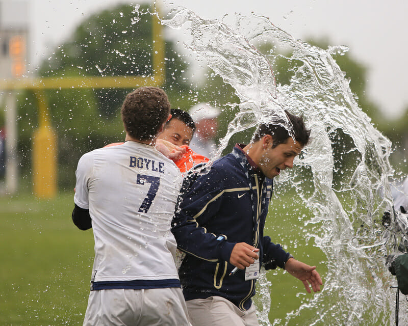 PItt coach Nick Kaczmarek gets the water jug treatment after Pitt's win over Central Florida in the finals of the D-I College Championships.