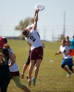 Players from Heist and Pop battle for a disc in the air at North Central Regionals