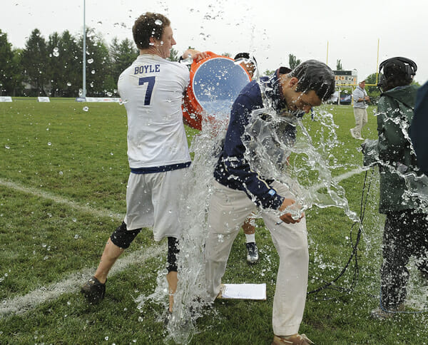 Players douse Pittsburgh coach Nick Kaczmarek after the team won its second straight College National Championship.
