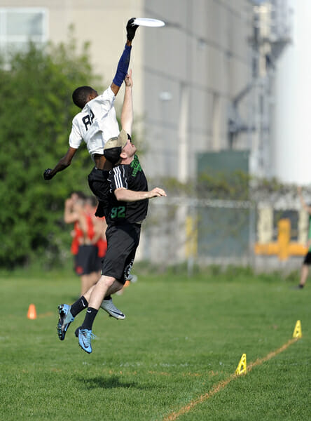Stevens Tech's Marques Brownlee flies above his defender at the 2013 D-III National Championships.