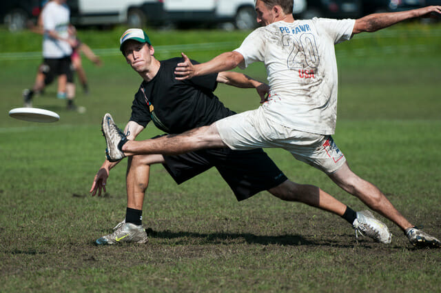 An outstretched Polar Bears defender misses the foot block.