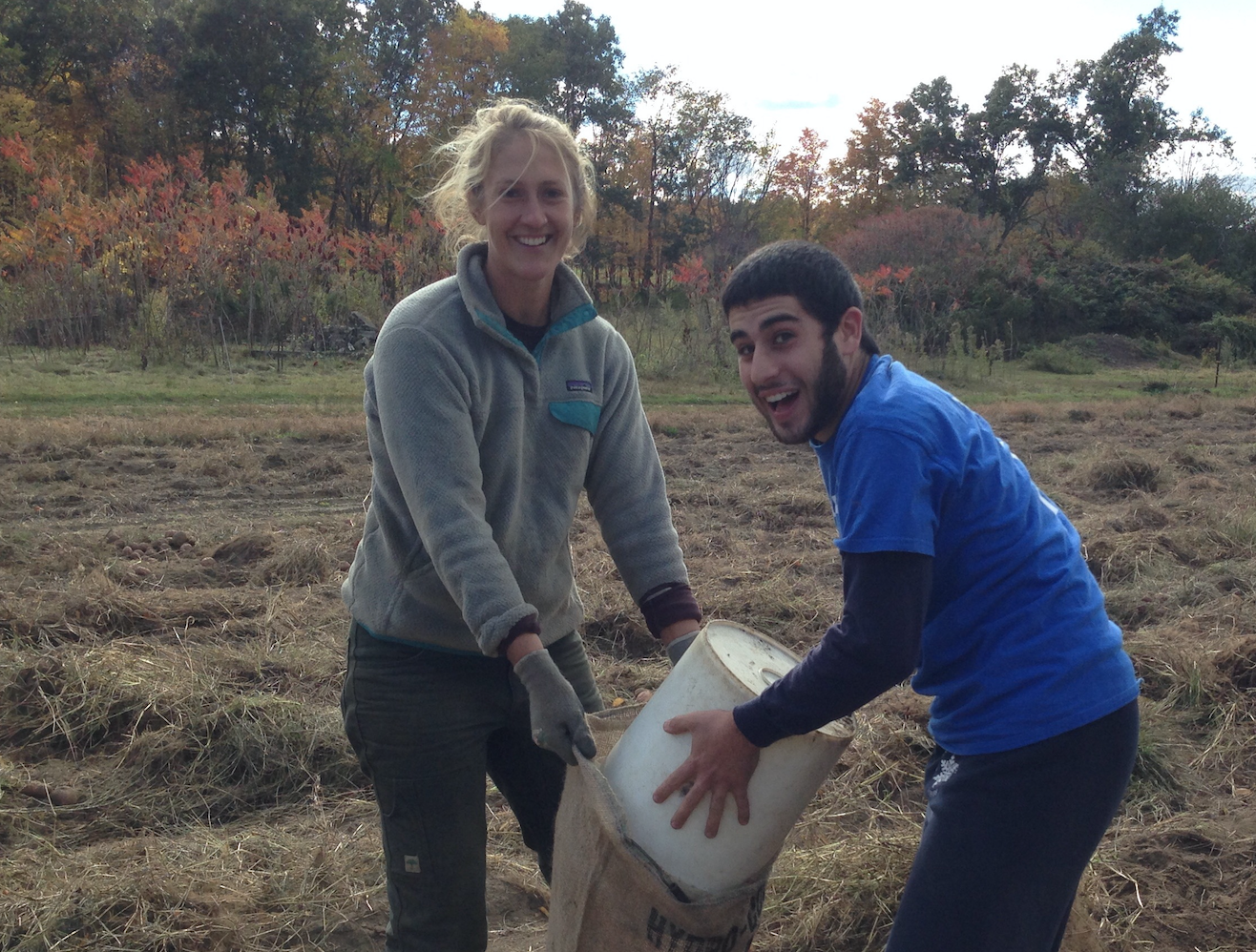 UMass requires all club players to perform community service. Captain Ben Sadok helps Ultiworld's Player of the Year Leila Tunnell pick potatoes at Brookfield Farm in Amherst. Bonding=buy-in.