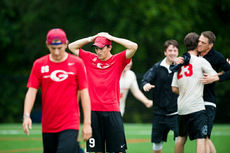 Georgia's Sam Little takes in the loss as Harvard celebrates. Photo: Kevin Leclaire -- UltiPhotos.com