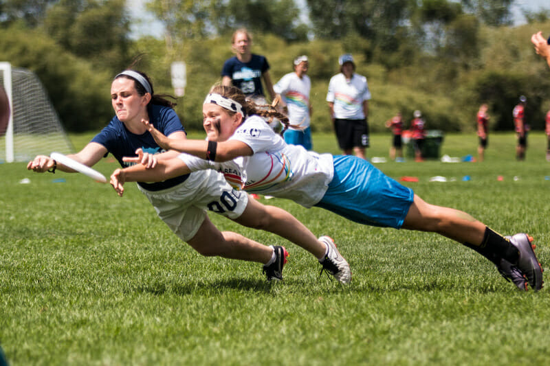 Lilly Shapiro (Superior #00) and Chloe Carothers-Liske (Happy Cows #64) lay out for a disc. Photo: Daniel Thai -- UltiPhotos.com